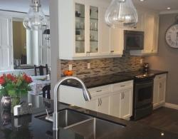 Microwave-hood combination above range, glass cabinet with glass shelving and lighting.  Light valence under cabinets with LED lighting.