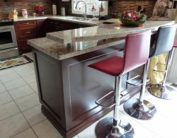 Raised bar with stainless-steel supports, granite countertop