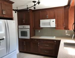 Maple-wood cabinetry in a terracotta stain