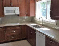 """Modern, square-cut, double-bowl, under-mount, stainless-steel 10""""- deep sink; Floor tiles of 18"""" x 18"""" porcelain"""