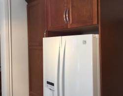 """Pantry unit, fridge with side gables and upper-cabinet with 24"""" storage"""