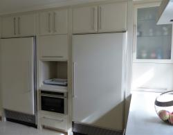 Existing Sub-Zero fridge and separate integrated freezer, updated with matching cabinet door panels