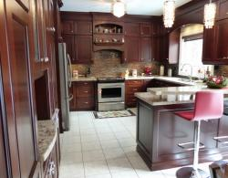 Impressive cabinetry, 9' ceiling, with Shaker-style door in maple, custom stain, raised-bar island