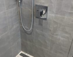 13 x 38 Start Groove Taupe wall tiles; Trough shower drain