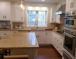 Kitchen reno included lighting, plumbing, tiling backsplash and refinishing of the existing wood flooring