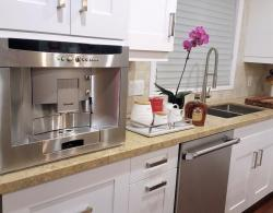 "Coffee bar, built-in Thermador coffee machine; Square under-mount 10 "" stainless-steel sink"