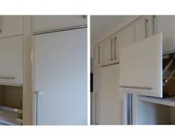 Wall-cupboard featuring doors with vertical-opening mechanism, providing ease of access