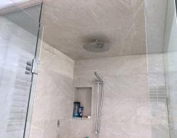 Ceiling-mounted, 12-inch rain head, with slide bar; built-in shampoo niche