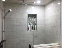 Built-in shampoo niche with mosiac-tile implant Kestle Interiors