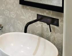 Brushed black aluminum, wall-mounted faucet,Kestle Interiors Newmarket Powder Room Design