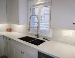 Undermount stainless-steel sink with contemporary square corners, professional style kitchen faucet