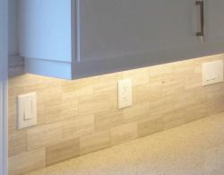 "Quartz countertop, 2"" x 4"" porcelain-tile backsplash with under-cabinet task lighting."