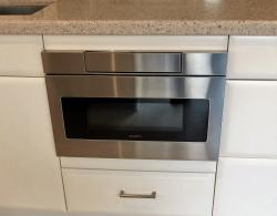 A SHARP microwave drawer is convenient and allows additional space on countertop