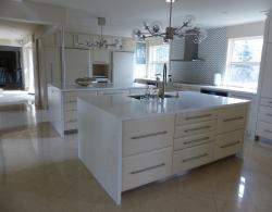 Quartz countertops, including two individual islands with waterfall effect on both ends
