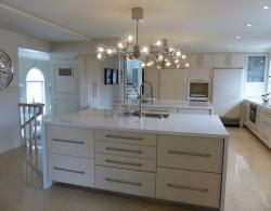 Retaining the existing layout that worked well for these homeowners, Kestle Interiors designed an updated, modern look for their existing traditional kitchen.  The result is stunning--lighter and fresher!