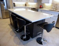 Maple-stained island with quartz countertop
