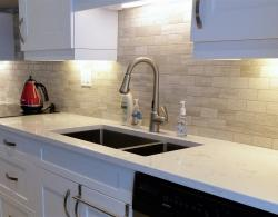 Backsplash featuring marble subway tiles
