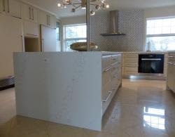 Island view showing waterfall effect, quartz countertop