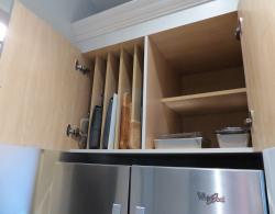 Efficient storage over fridge for trays and baking wear