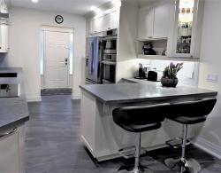 12 x 24 River Grafito Floor tiles; Quartz countertops; Cabinetry in Edgecomb Gray