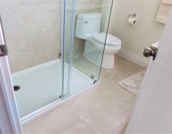 "Porcelain 12"" x 24"" floor & wall tiles; Acrylic shower base"