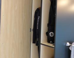 Cabinetry designed specifically for storing the homeowner's scuba equipment. Interior finish in birch plywood; Kestle Interiors bathroom design Newmarket